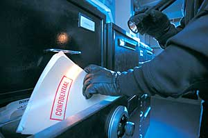 Thief stealing confidential documents